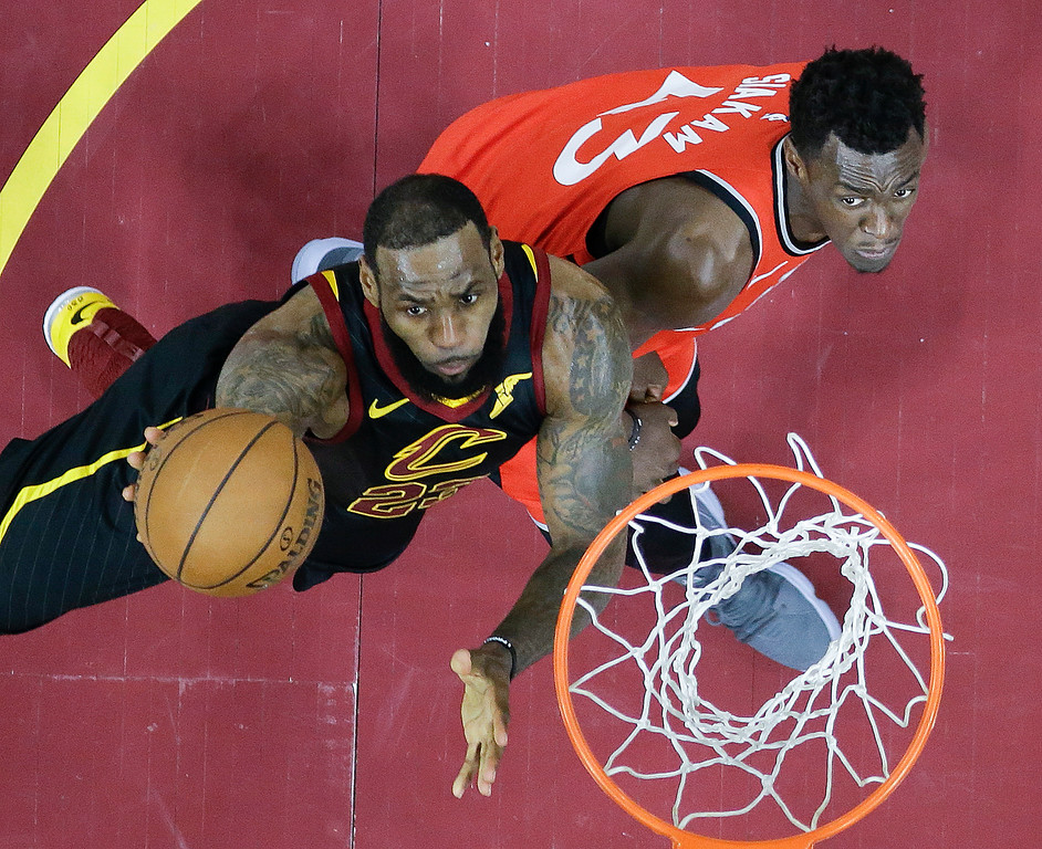 . Cleveland Cavaliers\' LeBron James shoots against Toronto Raptors\' Pascal Siakam (43), from Cameroon, in the first half of Game 4 of an NBA basketball second-round playoff series, Monday, May 7, 2018, in Cleveland. (AP Photo/Tony Dejak)