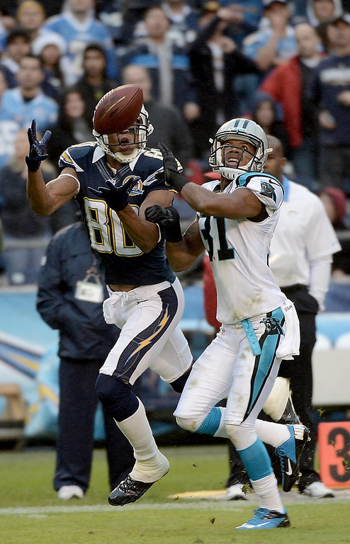 . Malcom Floyd #80 of the San Diego Chargers catches a pass and scores a touchdown against James Dockery #31 the Carolina Panthers on December 16, 2012 at Qualcomm Stadium in San Diego, California. (Photo by Donald Miralle/Getty Images)