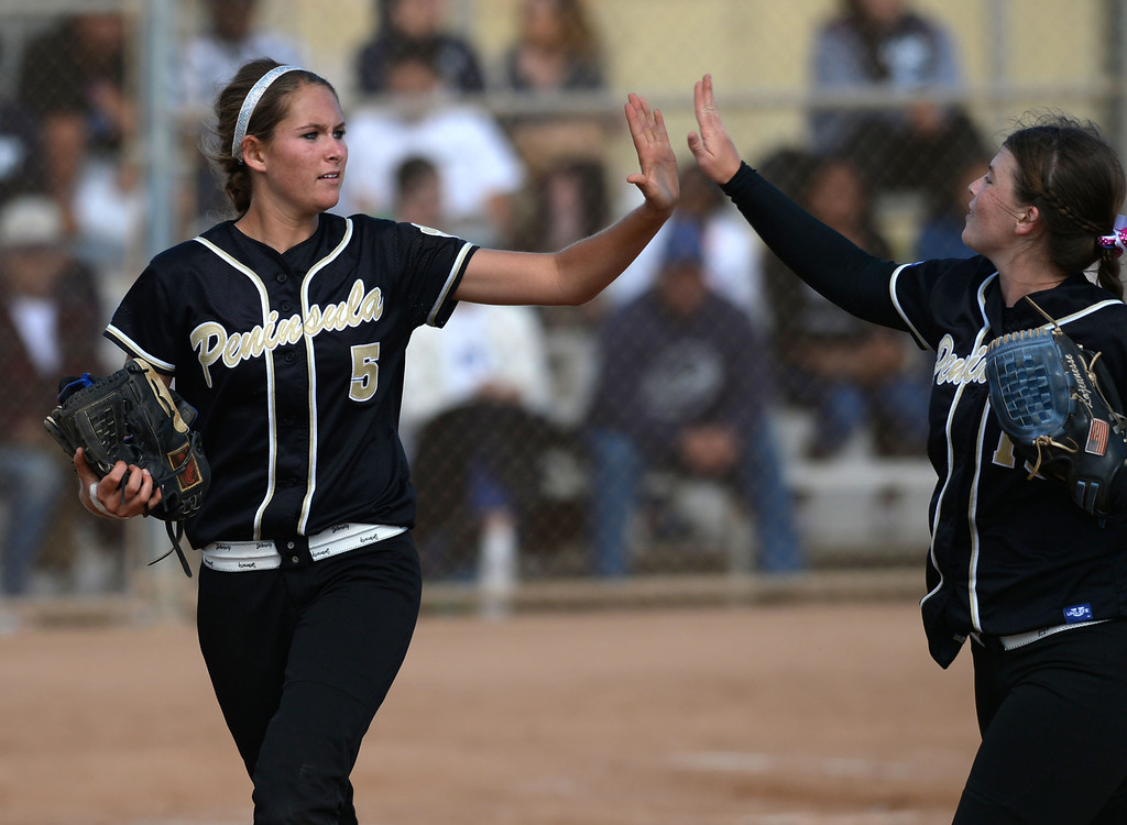 . Peninsula\'s Brooke Christensen (5) and Cassie Lajeunesse (15) celebrate getting out of an inning against North in a first round CIF SS Division III softball game Thursday in Torrance. Peninsula won 4-1. 20130516 Photo by Steve McCrank / Staff Photographer