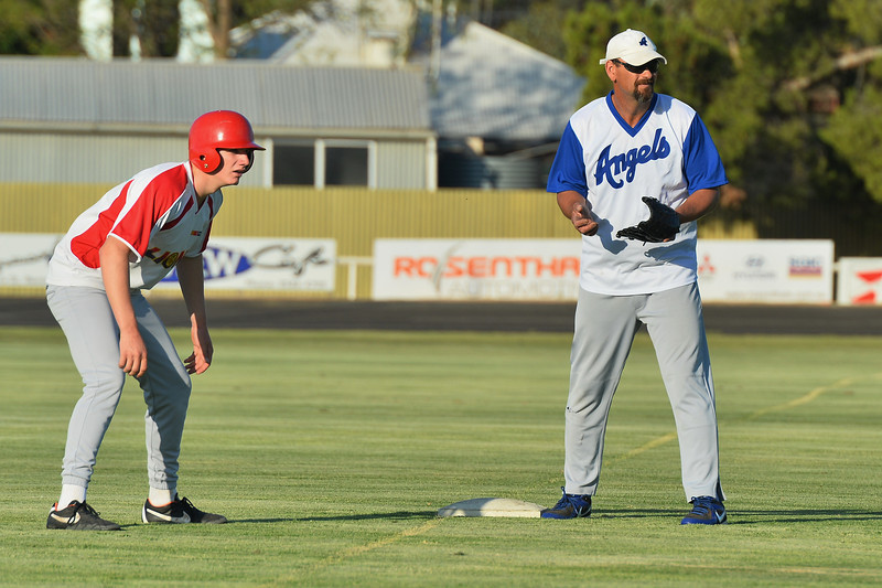 Kevin McDonald (Renmark) waits on 3rd for the throw as  Callan Thielle (Lyrup) gets ready to steal home.
