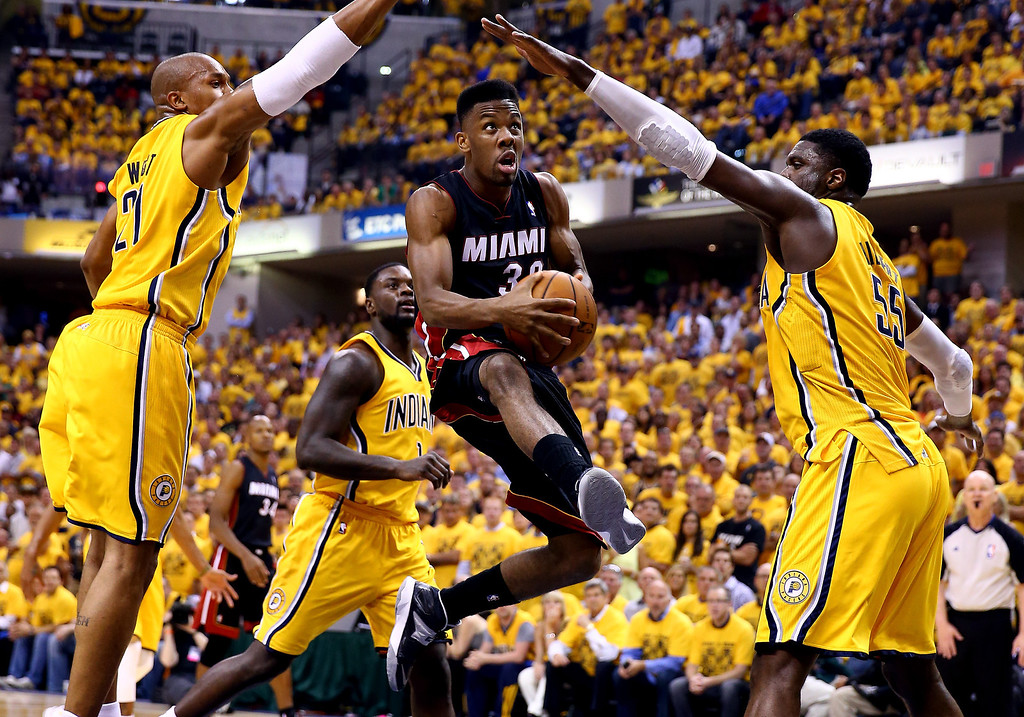 . Norris Cole #30 of the Miami Heat goes to the basket as David West #21 and Roy Hibbert #55 of the Indiana Pacers defend during Game Two of the Eastern Conference Finals of the 2014 NBA Playoffs at at Bankers Life Fieldhouse on May 20, 2014 in Indianapolis, Indiana.   (Photo by Andy Lyons/Getty Images)