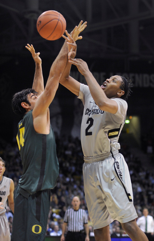 . BOULDER, CO. - MARCH 7: Colorado forward Xavier Johnson (2) challenged Oregon forward Arsalan Kazemi (14) in the second half. The University of Colorado men\'s basketball team defeated Oregon 76-53 Thursday night, March 7, 2013 at the CU Events Center in Boulder. (Photo By Karl Gehring/The Denver Post)