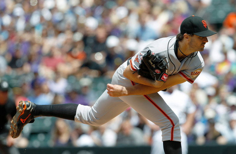 . San Francisco Giants starting pitcher Barry Zito works against the Colorado Rockies in the first inning of the MLB National League baseball game in Denver on Sunday, May 19, 2013. (AP Photo/David Zalubowski)
