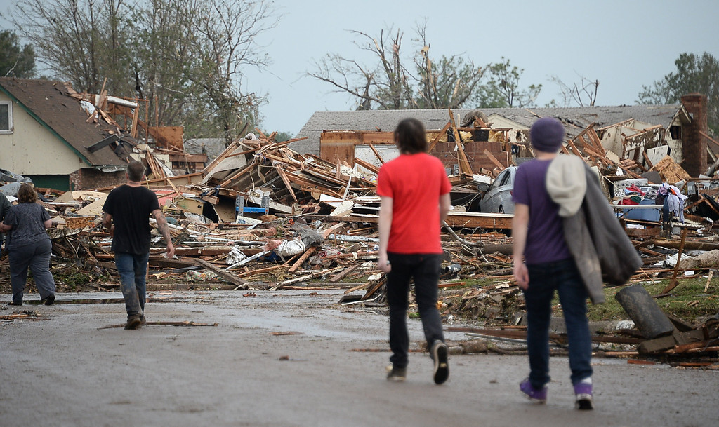 . Local Neighbors look at the homes destroyed. 