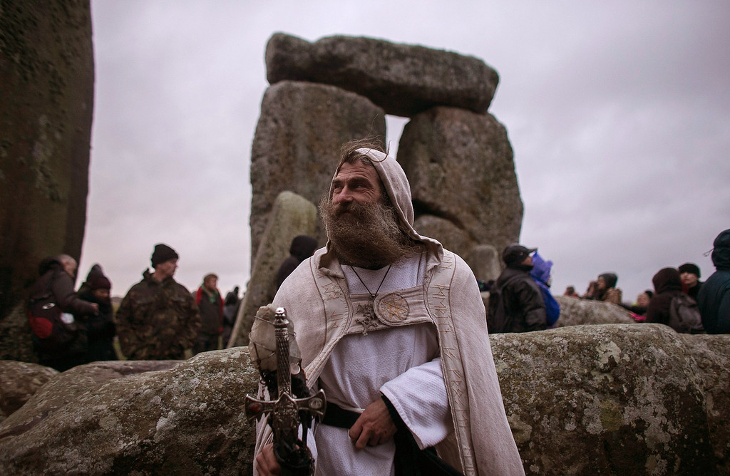 . Druid Merlin  poses for a photograph as druids, pagans and revellers gather, hoping to see the sun rise as they take part in a winter solstice ceremony at Stonehenge on December 21, 2013 in Wiltshire, England.  (Photo by Matt Cardy/Getty Images)