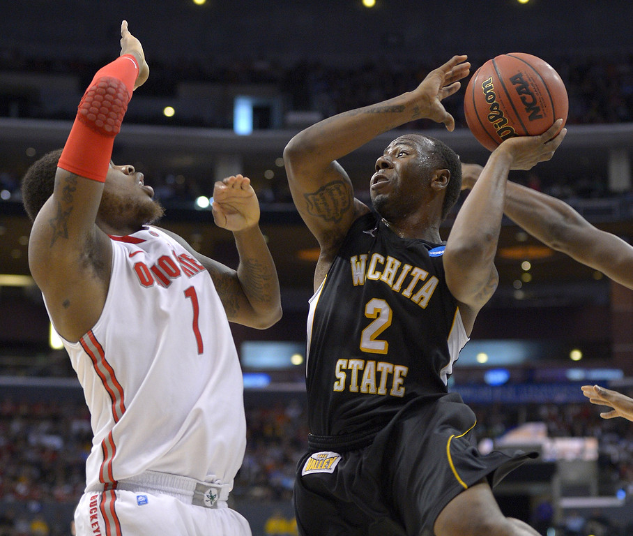 . Wichita State guard Malcolm Armstead (2) looks over Ohio State defender Ohio State\'s Deshaun Thomas during the first half of the West Regional final in the NCAA men\'s college basketball tournament, Saturday, March 30, 2013, in Los Angeles. (AP Photo/Mark J. Terrill)