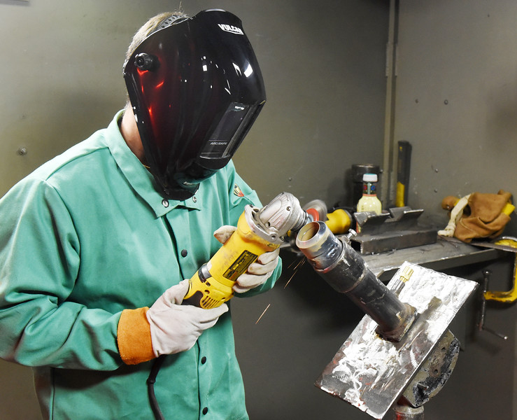 Harold Aughton/Butler Eagle: John Knifley of Louisana prepares to weld two piptes together in the Steamfitters welding shop.