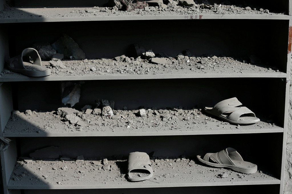 . Shelves for the shoes of Muslim worshippers are seen damaged at the Ameen mosque in Gaza City, northern Gaza Strip, destroyed by an Israeli strike, Tuesday, July 29, 2014. (AP Photo/Lefteris Pitarakis)