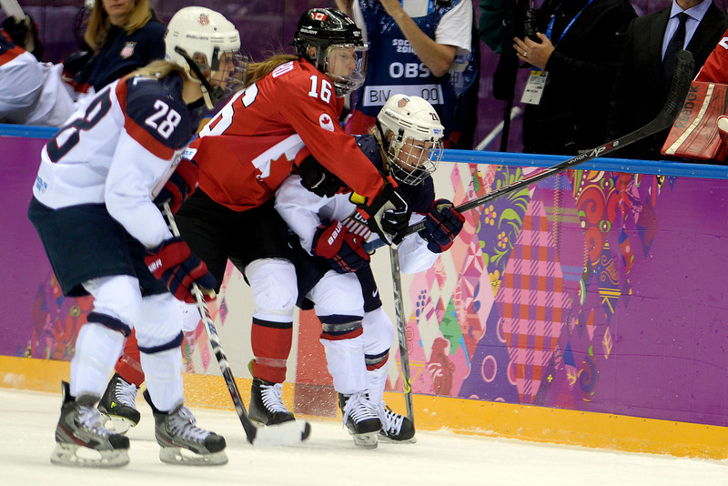 . Jayna Hefford (16) of the Canada defends Kendall Coyne (26) of the U.S.A. during the first period of the women\'s gold medal ice hockey game. Sochi 2014 Winter Olympics on Thursday, February 20, 2014 at Bolshoy Ice Arena. (Photo by AAron Ontiveroz/ The Denver Post)