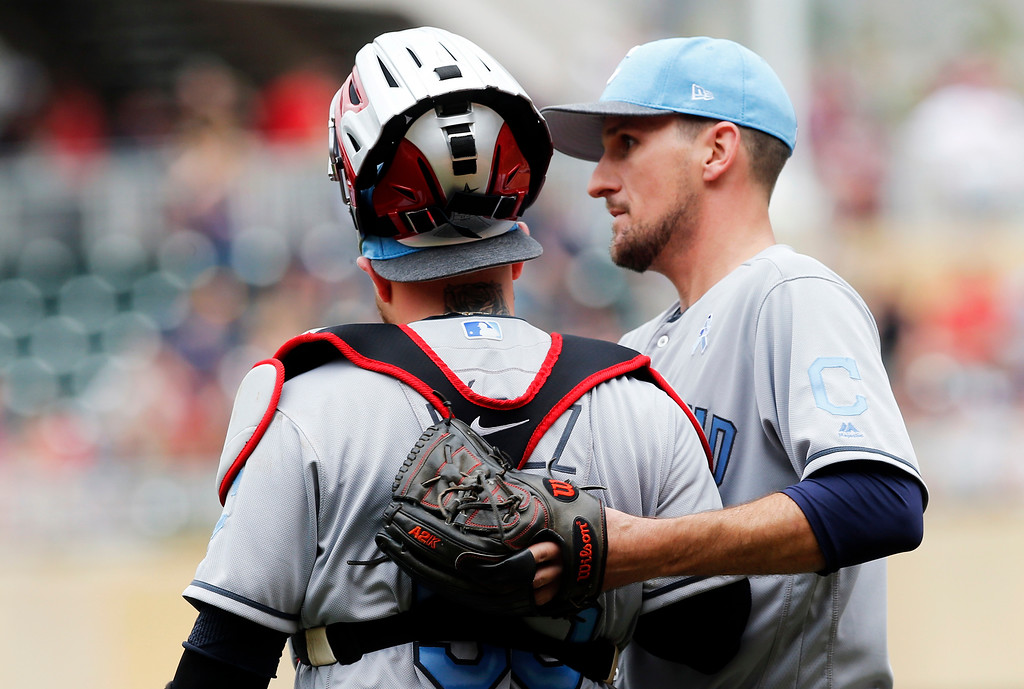 . Cleveland Indians relief pitcher Dan Otero, right, and catcher Roberto Perez celebrate as the Indians beat the Minnesota Twins 9-3 in game one of a baseball doubleheader Saturday, June 17, 2017, in Minneapolis. (AP Photo/Jim Mone)