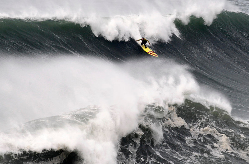 . US surfer Garrett McNanamara makes a take off on a wave during a surf session at Praia do Norte beach in Nazare, Portugal, Wednesday, Jan. 30, 2013. McNamara is said to have broken his own world record for the largest wave surfed when he caught a wave reported to be around 100ft,  off the coast of Nazare on Monday. If the claims are verified, it will mean that McNamara, who was born in Pittsfield, Massachusetts, USA, but whose family moved to Hawaii\'s North Shore when he was aged 11, has beaten his previous record, which was also set at Nazare, of 23.77 meters (78 feet) in November 2011. (AP Photo/Francisco Seco)