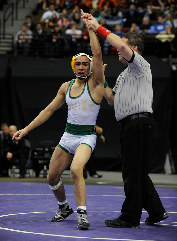. DENVER, CO. - FEBRUARY 23: Monte Vista High School junior Diondre Garcia celebrated his 7-6 win over Alamosa\'s Tel Kelley in the class 3A, 106-pound finals Saturday night. The CHSAA State Wrestling Tournament wrapped up, February 23, 2013, with final matches following the Parade of Champions at the Pepsi Center in downtown Denver. (Photo By Karl Gehring/The Denver Post)