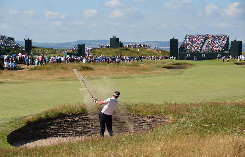 . Ian Poulter of England plays a bunker shot on the fifth hole during the first round of The 143rd Open Championship at Royal Liverpool on July 17, 2014 in Hoylake, England.  (Photo by Stuart Franklin/Getty Images)