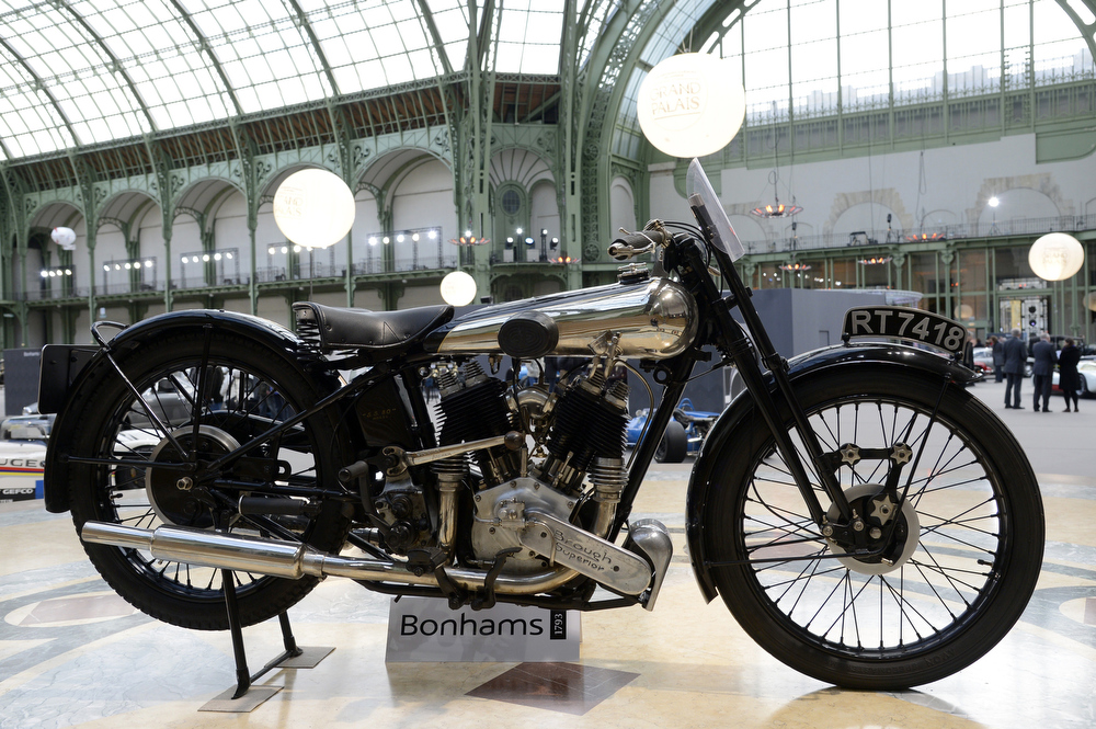 . A Brough Superior 996cc SS100 (1934) classic motorbike is pictured as luxury vintages cars and motorbikes are displayed at an auction at the Grand Palais on February 6, 2013 in Paris. 125 vintage motor cars, 100 collection motorbikes and a 1920\'s Gipsy Moth plane by De Havilland, will be presented at the Bonhams auction on February 7.  BERTRAND GUAY/AFP/Getty Images