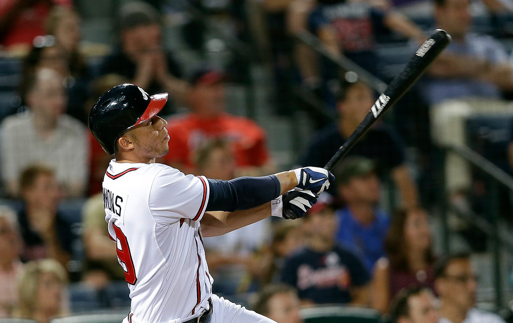 . Atlanta Braves\' Andrelton Simmons (19) drives in the game-winning run with a triple in the 10th inning of a baseball game against the Colorado Rockies. Atlanta won 9-8 in 10 innings. (AP Photo/John Bazemore)