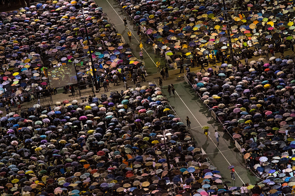 . Tens of thousands of people take part in a candlelight vigil on the 24th anniversary of the Tiananmen Square protests during heavy rain on June 4, 2013 in Hong Kong, Hong Kong.  Held to mark the crackdown on the pro-democracy movement in Beijing\'s Tiananmen Square on June 4, 1989.Pro-democracy groups hope to draw 150,000 people to the annual candlelight vigil in Hong Kong\'s Victoria Park, the only commemoration on Chinese soil. (Photo by Lam Yik Fei/Getty Images)