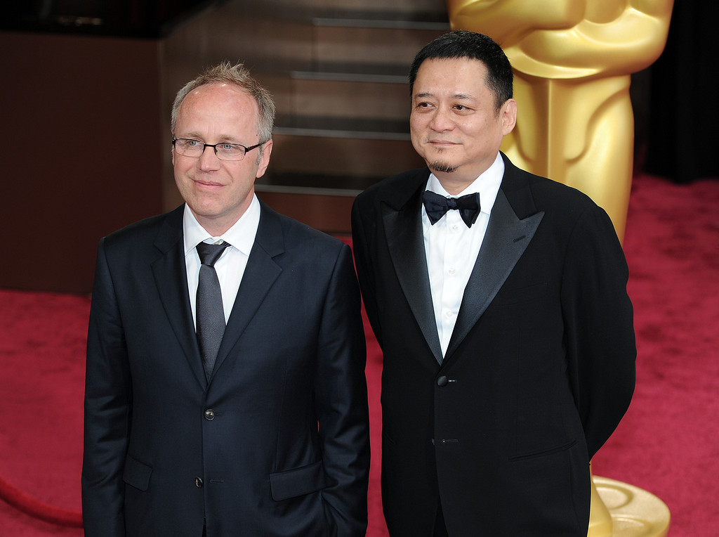 . Philippe Le Sourd and William Chang Suk Ping attend the 86th Academy Awards at the Dolby Theatre in Hollywood, California on Sunday March 2, 2014 (Photo by John McCoy / Los Angeles Daily News)