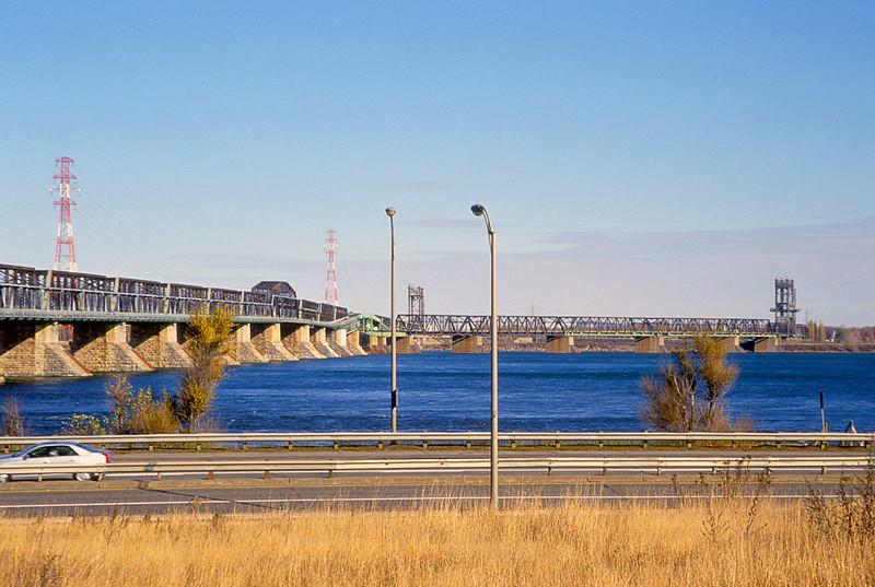 Pont Victoria with the dual lift bridges around St. Lambert locks viewed from Pointe Saint Charles.