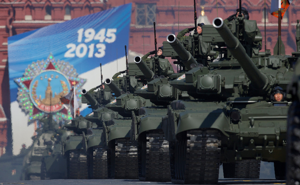 . Russian tanks move along Red Square during a Victory Day parade on Thursday, May 9, 2013. President Vladimir Putin\'s short speech Thursday came at the culmination of Victory Day, marking the defeat of Nazi Germany 68 years ago. It is Russia\'s most important secular holiday, honoring the huge military and civilian losses of World War II and showing off the country\'s modern arsenal.(AP Photo/ Ivan Sekretarev)