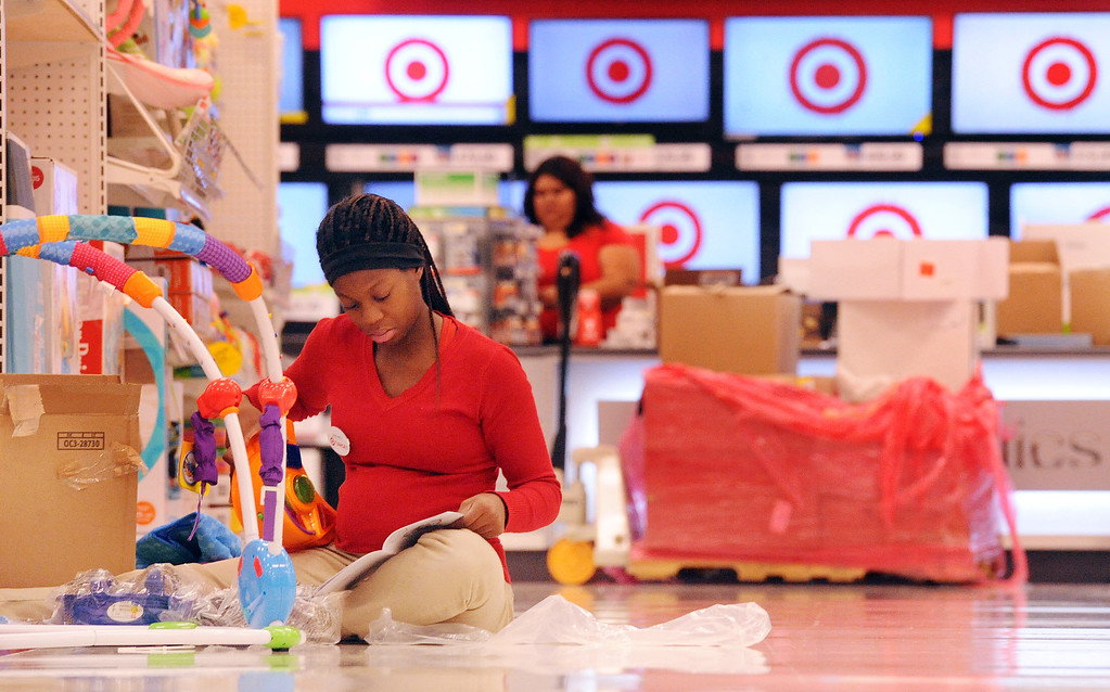 . Shavante Ford, 19, of Pomona, puts together an infant jumper Monday morning October 7, 2013 at the new Target store on Rio Rancho Road in Pomona. (Staff photo/Inland Valley Daily Bulletin)