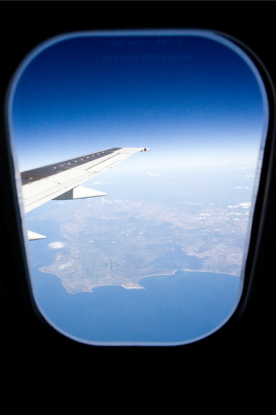 View through an airplane window with the wing included in the frame