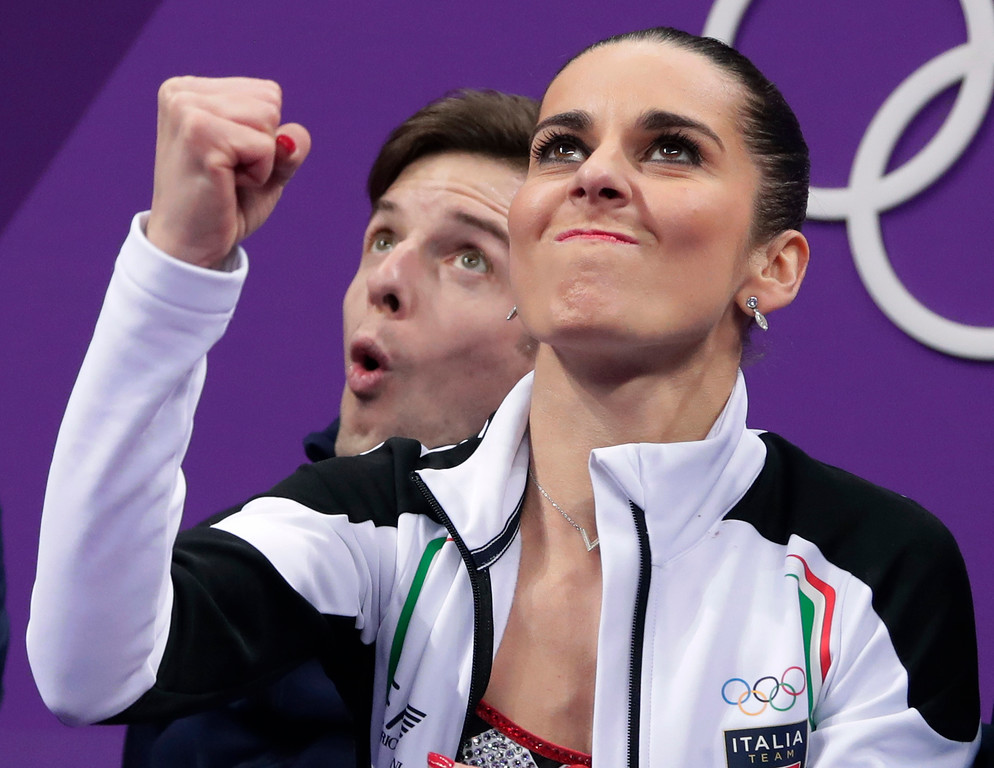 . Valentina Marchei and Ondrej Hotarek, of Italy, react as their scores are posted following their performance in the pairs free skate figure skating final in the Gangneung Ice Arena at the 2018 Winter Olympics in Gangneung, South Korea, Thursday, Feb. 15, 2018. (AP Photo/Julie Jacobson)