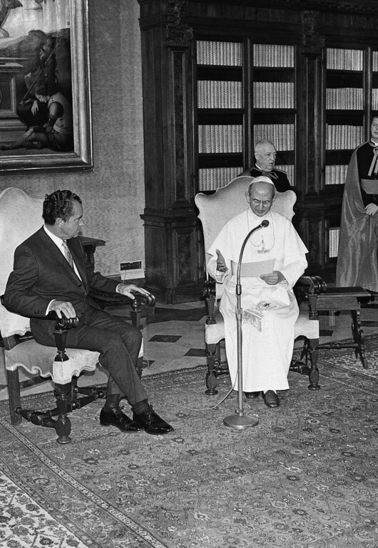 . U.S. President Richard M. Nixon listens to Pope Paul VI read a speech in English at the end of their closed talk in the pontiff\'s library at the Vatican City, March 2, 1969. Nixon later flew out of Rome for the United States, ending his European tour. (AP Photo)