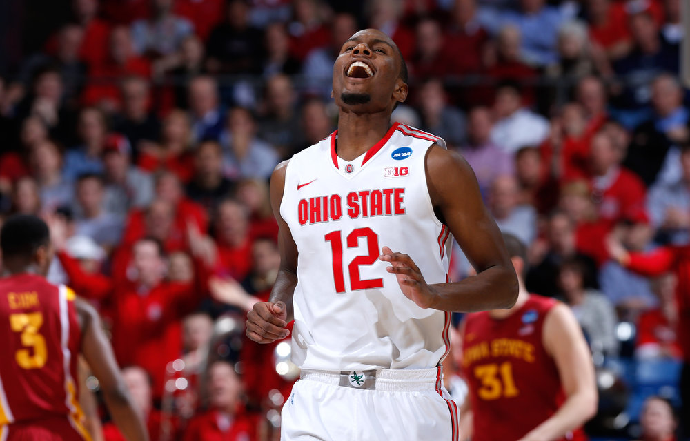 . Sam Thompson #12 of the Ohio State Buckeyes reacts after being called for a foul against the Iowa State Cyclones in the first half during the third round of the 2013 NCAA Men\'s Basketball Tournament at UD Arena on March 24, 2013 in Dayton, Ohio.  (Photo by Joe Robbins/Getty Images)