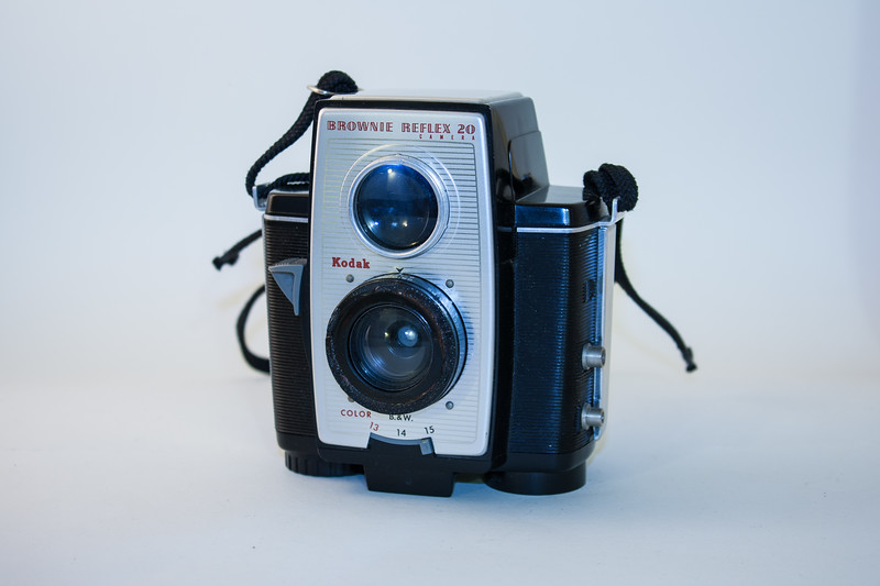 Kodak Brownie Reflex 20 This was the end of the line as far as Kodak's production of cameras for its 620 film (6cmx6cm negatives). In the US the Reflex 20 was produced between 1959 and 1966; in the UK the production run was a slightly shorter 1960-1965. This TLR-style camera has an f/11 meniscus lens (f/20 and f/26 lenses were also available), and the shutter is fixed at 1/40th sec. Three aperture stops are available, which allow the use of colour film.  Kodak, Brownie & Hawkeye 620 Rollfilm Cameras user.itl.net/~kypfer/620roll.htm  Using 120 Film in a 620 Camera www.toptown.com/nowhere/kypfer/120-620faq.htm.