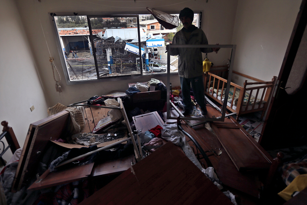. A Lebanese man checks the damage inside his children\'s bedroom that was caused by a deadly car bomb that exploded Saturday evening near a gas station, in the predominately Shiite town of Hermel, about 10 miles (16 kilometers) from the Syrian border in northeast Lebanon, Sunday, Feb. 2, 2014. (AP Photo/Hussein Malla)