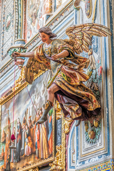 Polychromatic angel holding an oil lamp, carving by Bartolome Garcia (1730), church of Santa Paula Convent, Seville, Spain
