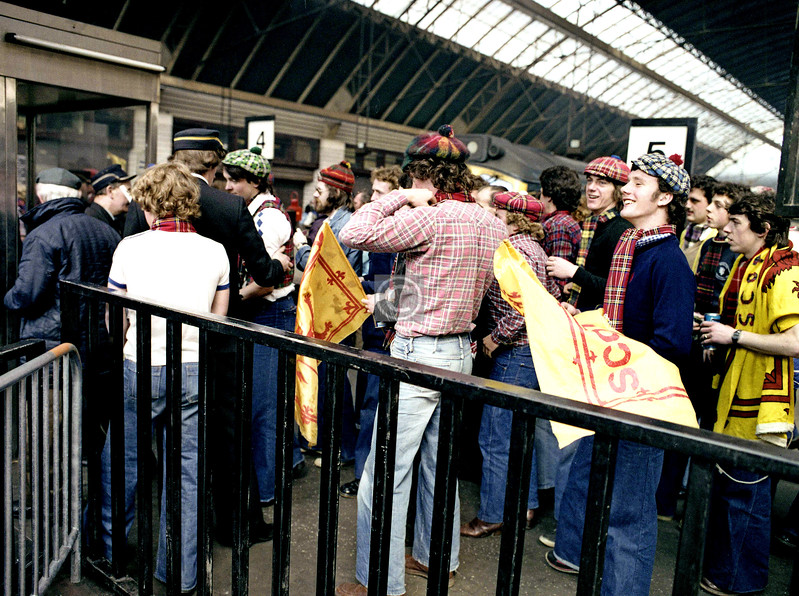 An out-of-town battalion of the Tartan Army arrives at Queen St for the Scotland - England match at Hampden on 20th May 1978.  I will gloss over the result in two words, Steve Coppell.  Note the two fly guys, young and old, sneaking behind the ticket collectors.
