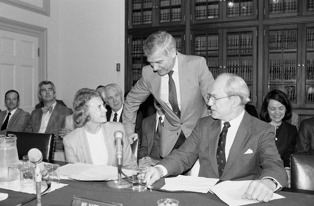 . Supreme Court Justice Sandra Day O?Connor, left, with Justice Byron White, chat with Sen. Mark Hatfield (R-Ore.), center, May 1, 1985 on Capitol Hill in Washington prior to appearing before a Senate subcommittee on the Judiciary to address the budget requirements of the Supreme Court for fiscal year 1986. (AP Photo/Barry Thumma)