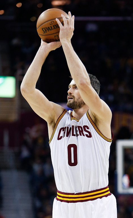 . Cleveland Cavaliers\' Kevin Love (0) shoots against the Portland Trail Blazers during the first half of an NBA basketball game Wednesday, Nov. 23, 2016, in Cleveland. (AP Photo/Ron Schwane)