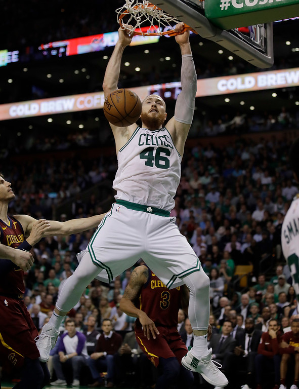 . Boston Celtics center Aron Baynes dunks against the Cleveland Cavaliers during the second half in Game 2 of the NBA basketball Eastern Conference finals, Tuesday, May 15, 2018, in Boston. (AP Photo/Charles Krupa)