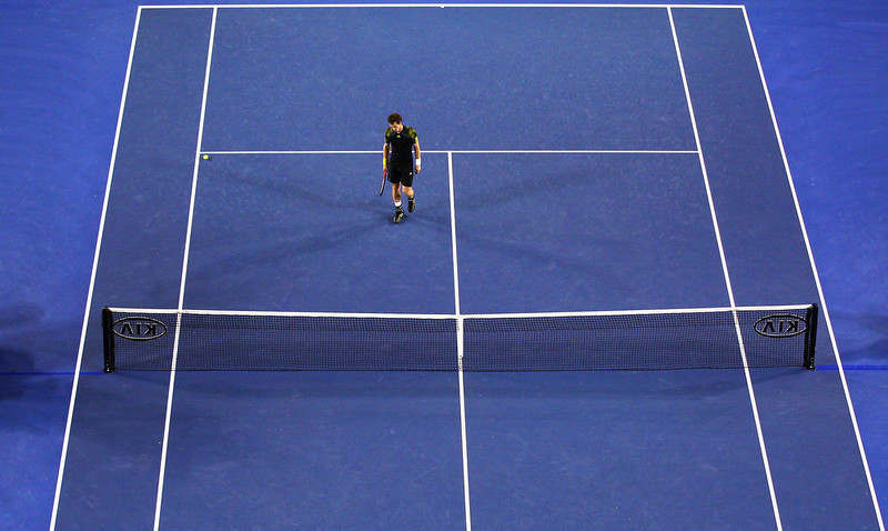 . Andy Murray of Great Britain looks dejected after losing championship point in his men\'s final match against Novak Djokovic of Serbia during day fourteen of the 2013 Australian Open at Melbourne Park on January 27, 2013 in Melbourne, Australia.  (Photo by Ryan Pierse/Getty Images)