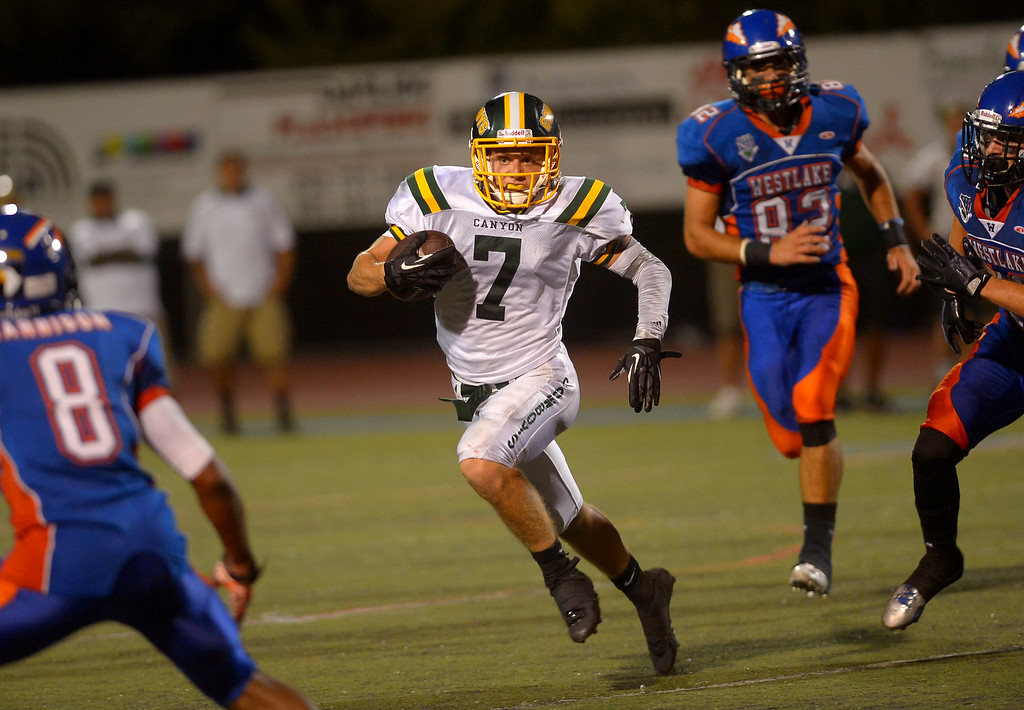 . Canyon High School\'s Zach Cuha carries the ball against Westlake High August 30, 2013 in Westlake Village, CA.(Andy Holzman/Los Angeles Daily News)