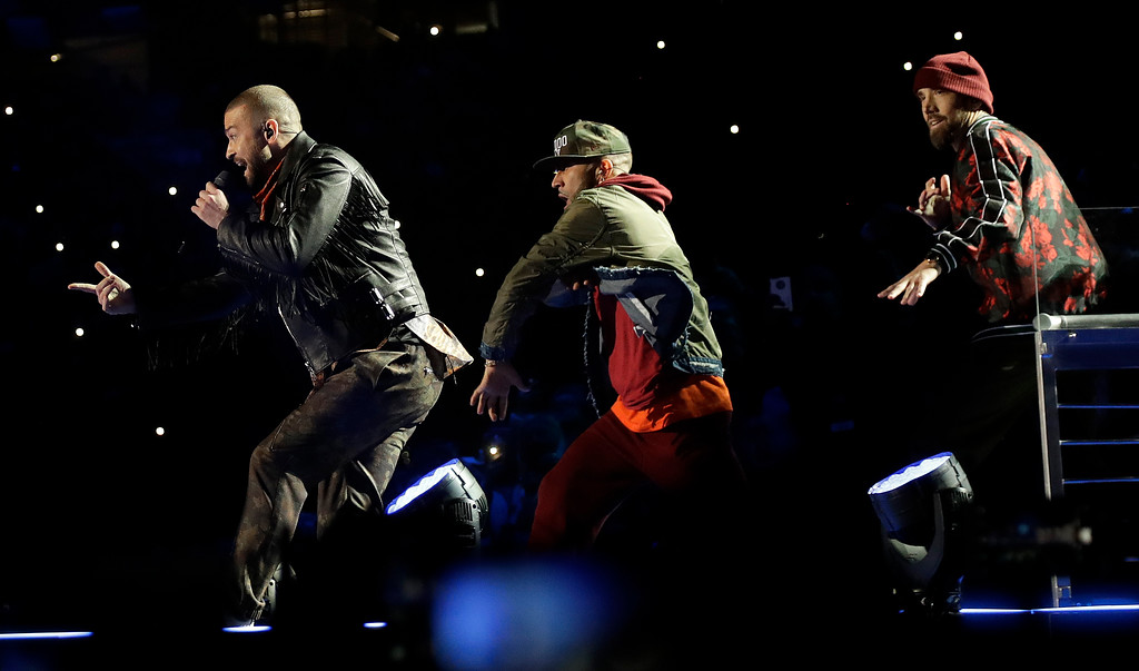 . Justin Timberlake, left, performs during halftime of the NFL Super Bowl 52 football game between the Philadelphia Eagles and the New England Patriots Sunday, Feb. 4, 2018, in Minneapolis. (AP Photo/Matt Slocum)