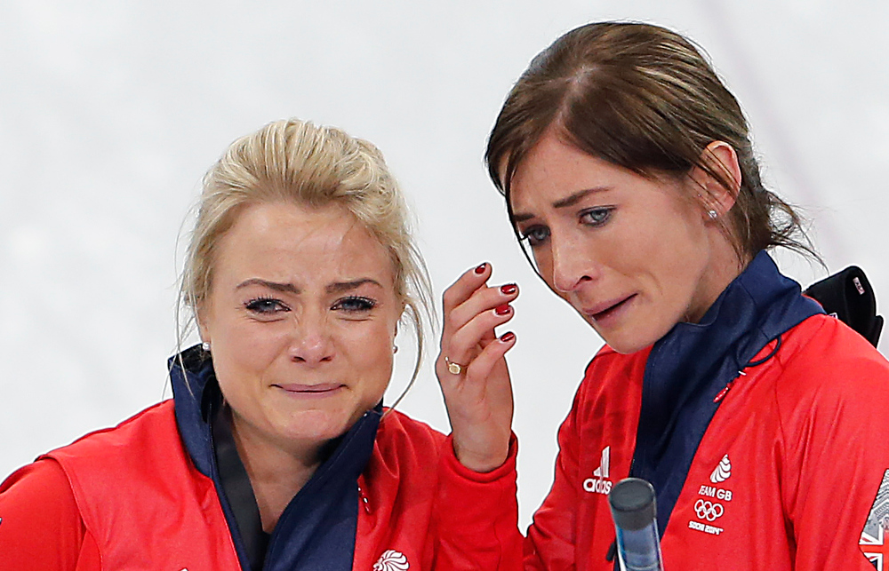 . Britain\'s skip Eve Muirhead, right, and Anna Sloan, left, cry as they celebrate beating Switzerland in the women\'s curling bronze medal game at the 2014 Winter Olympics, Thursday, Feb. 20, 2014, in Sochi, Russia. (AP Photo/Wong Maye-E)