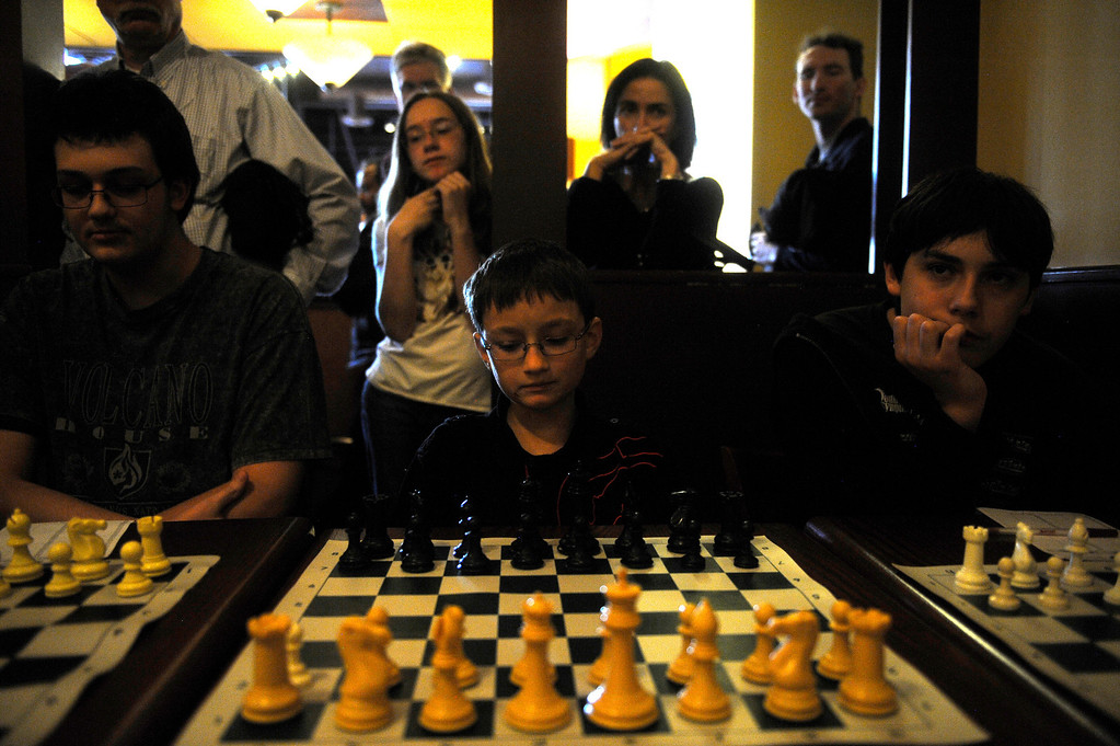 . DENVER CO: Nov. 2, 2013  Aiden Sirotkine, 9, waits during the game against grand chess master Timur Gareev on Nov. 2, 2013. Gareev, who was blindfolded during play, took on 15 talented players from around the state of Colorado. Gareev announced that the game might take up to 5 hours.  (Photo By Erin Hull/The Denver Post)