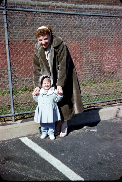 mommy in fur coat susan in bonnet spring 1958.jpg