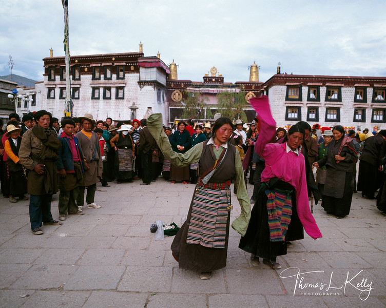 Women wearing traditional pangden dance on the square before the Jokhung.