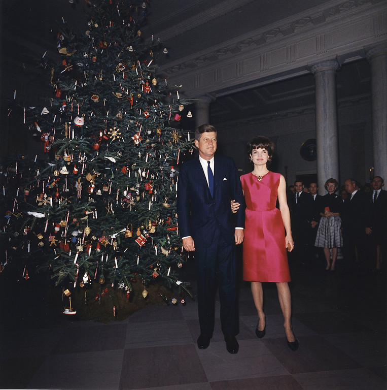 . The president and first lady attend a White House staff Christmas Party on Dec. 7, 1962 in Washington. John F. Kennedy Presidential Library and Museum