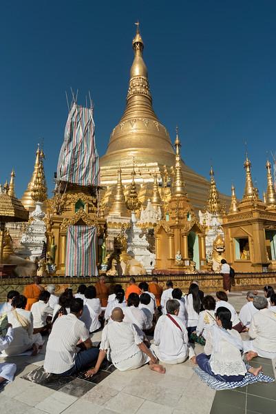 Group of pilgrims at Shwedagon Pagoda, Yangon (Rangoon), Myanmar (Burma)