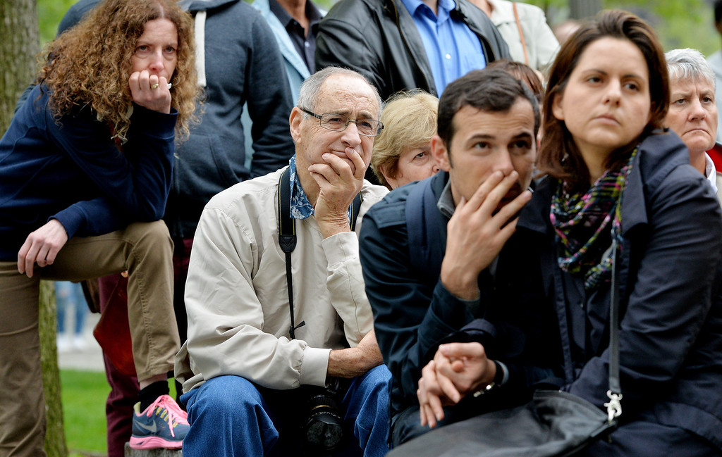 . People gather on the plaza of the National September 11 Memorial to watch the telecast of the dedication ceremony for the museum at ground zero May 15, 2014 in New York City.  (Photo by Justin Lane-Pool/Getty Images)
