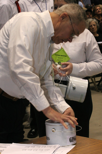 Officials get the buckets ready for the caucus vote in Boise, Idaho.