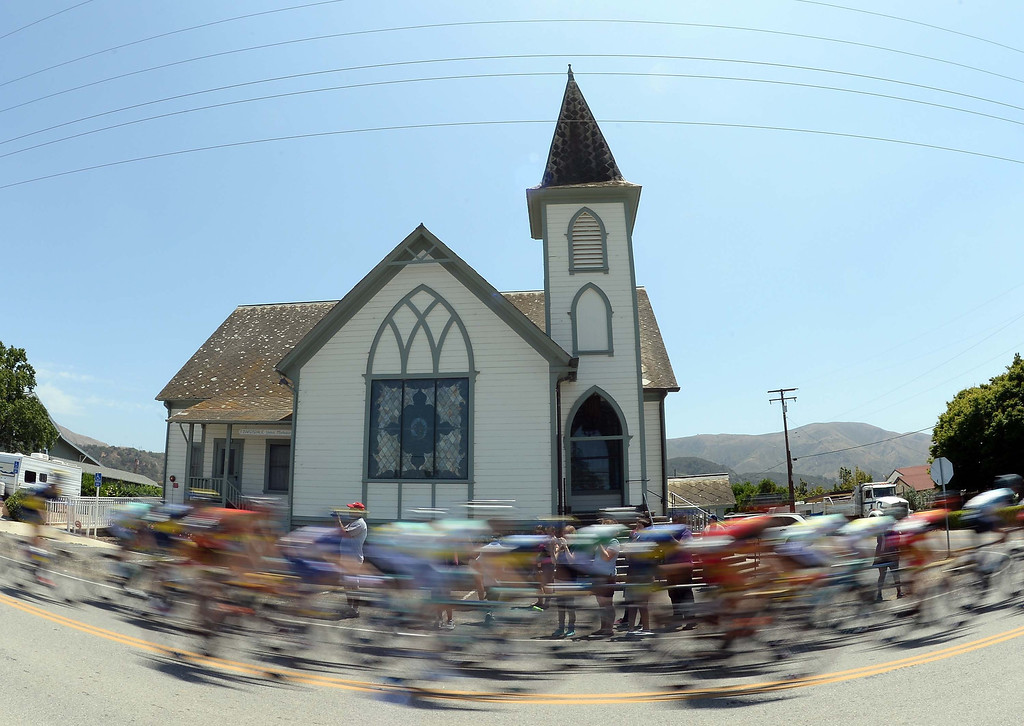 . The peleton speed by Bardsdale United Methodist Church during Stage 4 of the Tour of California on May 15, 2013 in Fillmore, United States.  (Photo by Harry How/Getty Images)