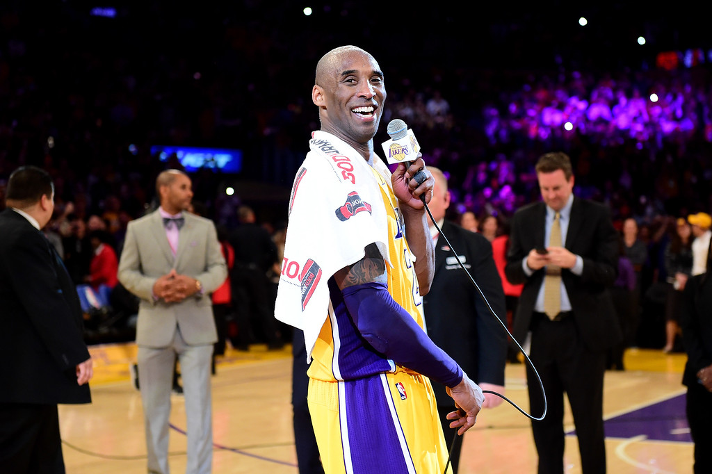 . LOS ANGELES, CA - APRIL 13:  Kobe Bryant #24 of the Los Angeles Lakers addresses the crowd after scoring 60 points in his final NBA game at Staples Center on April 13, 2016 in Los Angeles, California. The Lakers defeated the Utah Jazz 101-96. NOTE TO USER: User expressly acknowledges and agrees that, by downloading and or using this photograph, User is consenting to the terms and conditions of the Getty Images License Agreement.  (Photo by Harry How/Getty Images)