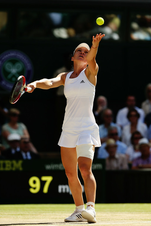 . Simona Halep of Romania serves during her Ladies\' Singles semi-final match against Eugenie Bouchard of Canada on day ten of the Wimbledon Lawn Tennis Championships at the All England Lawn Tennis and Croquet Club  on July 3, 2014 in London, England.  (Photo by Matthew Stockman/Getty Images)