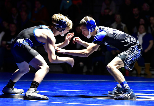 12/12/2018 Mike Orazzi | Staff Bristol Eastern's Mason Lishness and Southington's Ben Gorr in the 113 match at Southington High School Wednesday night.